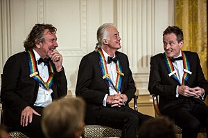 (L-R) Led Zeppelin's Robert Plant, Jimmy Page, and John Paul Jones attend the Kennedy Center Honors reception at the White House