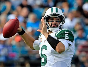 Mark Sanchez  attempts a pass against the Jacksonville Jaguar