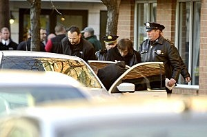 A man is escorted to a car by law enforcement in Hoboken  in connection with the Connecticut school shooting