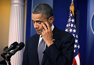 President Barack Obama wipes tears as he makes a statement in response to the elementary school shooting in Connecticut