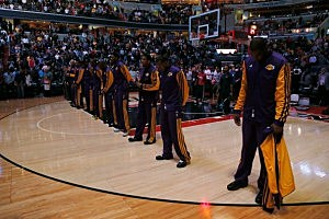 Members of the Los Angeles Lakers and the crowd observe a moment of silence for the victims of the mass school shooting at Sandy Hook Elementary School in Newtown, Connecticut,