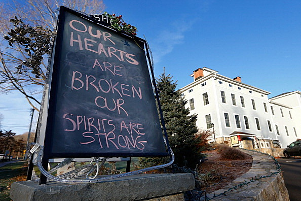 A sign outside of a business in downtown Newtown reads, 'Our hearts are broken, our spirits are strong',