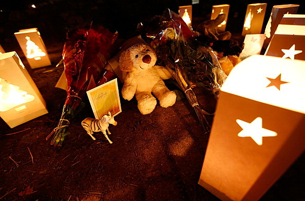 Candles surround gifts and flowers that were left in honor of the victims of the mass shooting at Sandy Hook elementary school