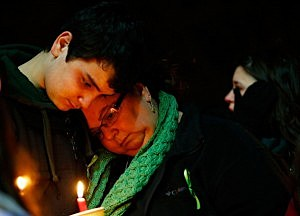 Donna Soto (R), mother of Victoria Soto, the first-grade teacher at Sandy Hook Elementary School who was shot and killed while protecting her students, leans on her son Matthew while mourning their loss at a candlelight vigil in honor of Victoria at Stratford High School