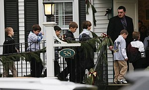 Boys walk to enter Honan Funeral Home before the funeral for 6-year-old Jack Pinto