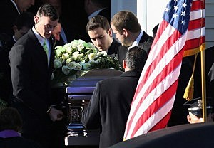 Pallbearers carry out the casket of slain teacher Victoria Soto, 27, following her funeral at the Lordship Community Church in Stratford, Connecticut