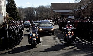 The hearse carrying the casket of Daniel Barden, 7, a victim of the shooting at Sandy Hook Elementary School, leaves St. Rose of Lima Church