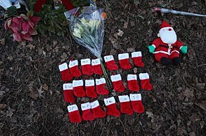 Twenty miniature stockings adorn a makeshift memorial for the mass shooting victims