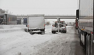 S A tow truck prepares to aid a stranded truck on Interstate I-90 near Madison, Wisconsin