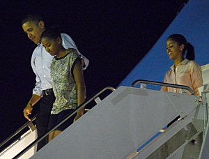 resident Barack Obama disembarks Obama Air Force One with daughters Natasha and Malia at Joint Base Pearl Harbor-Hickam