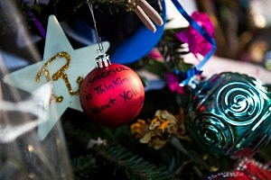 "A Christmas tree ornament reads ""America is Thinking about you!"" at a memorial for those killed in the school shooting at Sandy Hook Elementary School"