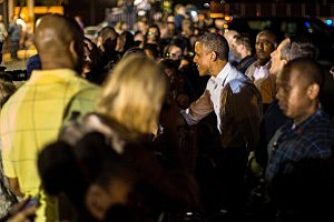 President Barack Obama greets well wishers before boarding Air Force One at Joint Base Pearl Harbor-Hickam  in Honolulu, Hawaii.