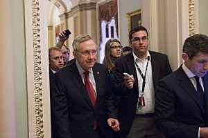 Senate Majority Leader Harry Reid (D-NV) ignores questions from reporters after meeting with President Obama and other Congressional leaders at the White House,