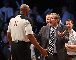 Interim Coach P.J. Carlesimo of the Brooklyn Nets argues with referee Kevin Cutler