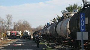 Response crews pump an acetone and vinyl chloride mixture into rail cars in Paulsboro