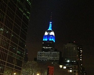 Empire State Building lit up in blue & gold in honor of the victims of the Connecticut school shooting victims (Twitter)