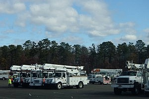 JCP+L utility trucks in a staging area in Ocean County (Facebook)