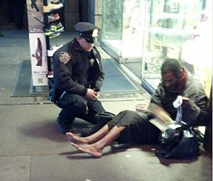 NYPD Officer Larry DePrimo gives Jeffrey Hillman a pair of boots