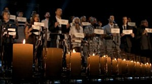 Contestants, hosts and judges sing Hallalejah in honor of the Newtown, CT shooting  victims.
