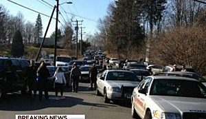 Parents and law enforcement on road leading to Sandy Hook Elementary School