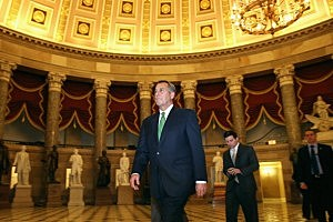 Speaker of the House John Boehner (R-OH) (C) walks through Statuary Hall
