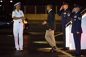 President Barack Obama (2L) arrives at Joint Base Pearl Harbor-Hickam to resume his vacation