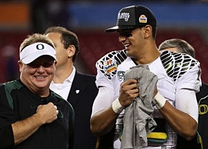 Head coach Chip Kelly celebrates with Marcus Mariota #8 of the Oregon Ducks after their 35 to 17 win over the Kansas State Wildcats in the Tostitos Fiesta Bowl