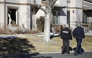 Aurora, Colorado Police walk by the scene where four people were killed