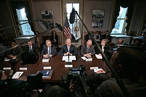 Vice President Joe Biden (C) makes brief remarks to the press at the beginning of a meeting with U.S. Attorney General Eric Holder (3rd L) and gun violence survivors and victims and gun safety advocacy groups