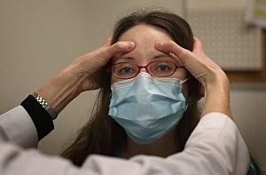 Dr. Anne Furey Schultz examines Alice Corcoran, who was experiencing flu-like symptoms,