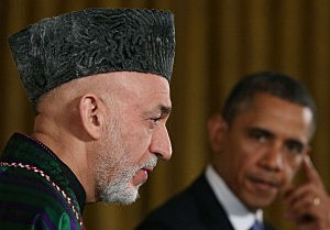 President Barack Obama (R) and Afghan President Hamid Karzai speak to the media during a joint news conference in the East Room of the White House