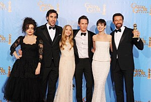 "(L-R) Actors Helena Bonham Carter, Sacha Baron Cohen, Amanda Seyfried, Eddie Redmayne, Anne Hathaway and Hugh Jackman of ""Les Miserables"" pose in the press room"