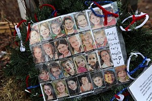 Photos of Sandy Hook Elementary School massacre victims sits at a small memorial near the school