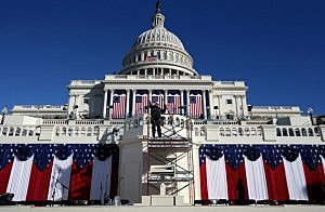 A worker removes scaffolding at the west front of the Capitol building where President Barack Obama take the oath of office during his second inauguration