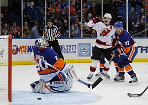 Patrik Elias #26 of the New Jersey Devils reacts to the game winning goal