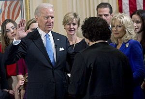 . Vice President Joe Biden (2nd L) takes the oath of office from U.S. Supreme Court Justice Sonia Sotomayor (2nd R) as his wife Dr. Jill Biden (R) looks on during the official swearing-in ceremony at the Naval Observatory