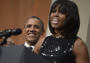 President Barack Obama listens as First Lady Michelle Obama delivers remarks at the Inaugural Reception at the National Building Museum