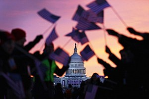 People wave American flags near the U.S. Capitol building