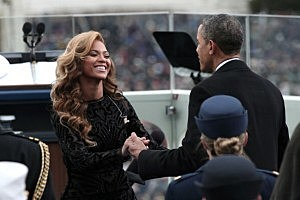 President Barack Obama greets singer Beyonce after she performs the National Anthem