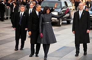 President Barack Obama and First lady Michelle Obama walk the route as the presidential inaugural parade winds through the nation's capital