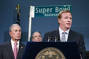 New York City Mayor Michael Bloomberg (L) looks on as National Football League (NFL) Commissioner Roger Goodell (R) speaks at a City Hall press conference announcing plans for Super Bowl XLVIII