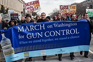 Vincent Gray (C), Mayor of the District of Columbia, leads a march for stricter gun control laws