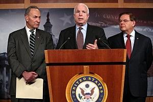 U.S. Sen. John McCain (R-AZ) (C) speaks as Sen. Charles Schumer (D-NY) (L) and Sen. Robert Menendez (D-NJ) (R) listen during a news conference on a comprehensive immigration reform framework