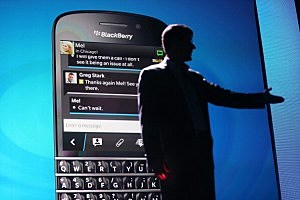 BlackBerry Chief Executive Officer Thorsten Heins speaks in front of a display of one of the new Blackberry 10 smartphones at the BlackBerry 10 launch event by Research in Motion at Pier 36 in Manhattan