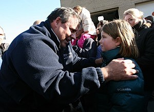 Governor Chris Christie hugs Jinger from Middletown after Hurricane Sandy