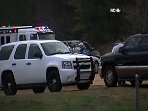 Police near the scene of hostage situation in Midland City, Alabama