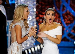 Miss South Carolina Ali Rogers (L) and Miss New York Mallory Hytes Hagan react during the 2013 Miss America Pageant