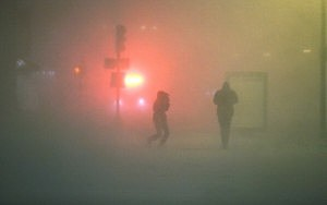 People walk through the blowing snow while a blizzard arrives in Boston's  Back Bay neighborhood