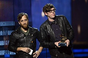 "Dan Auerbach (L) and Patrick Carney of the Black Keys accept Best Rock Performance for ""Lonely Boy"" onstage at the 55th Annual GRAMMY Awards"