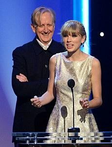 """T. Bone Burnett and Taylor Swift, winner Best Song Written For Visual Media for """"Safe & Sound (From The Hunger Games),"""